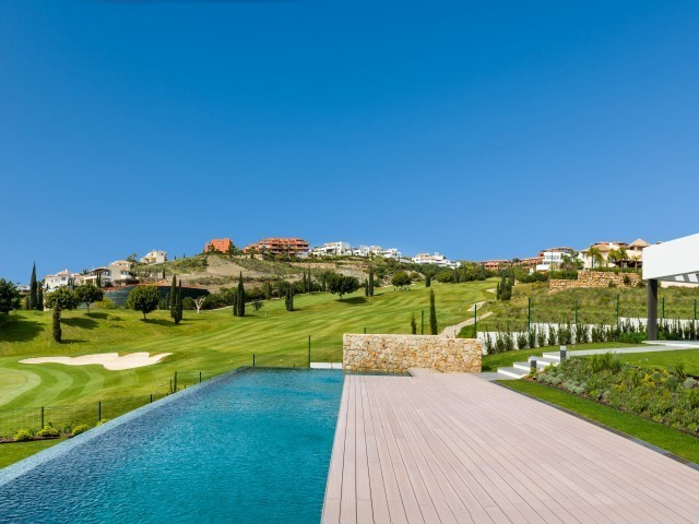 4 Bedroom contemporary new villa for sale with private pool, sea views and is front line golf on the Los Flamingos Golf Resort.